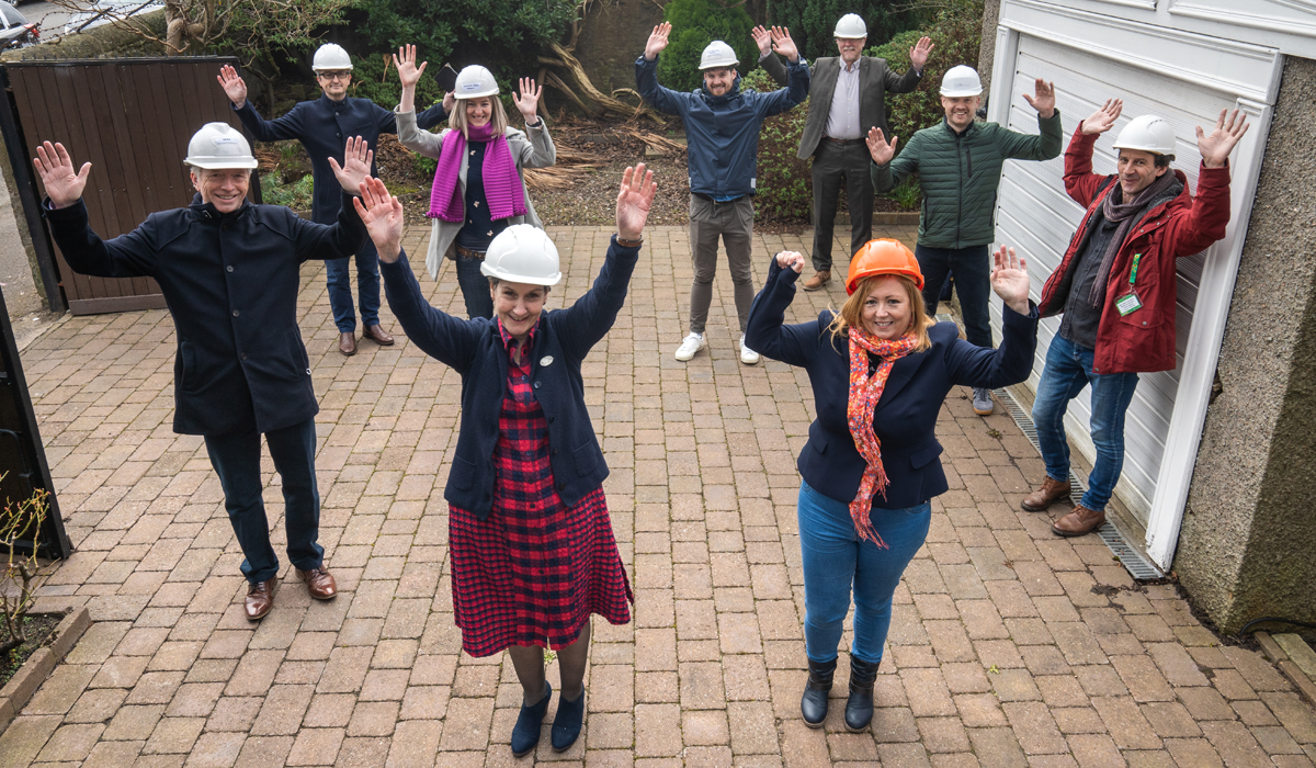 Key figures behind Common ground share offer pose outside their new Peffermill property