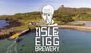 Isle of Eigg Brewery logo superimposed on a photo of Eigg's harbour
